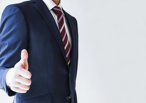 Thumbs up of businessmen