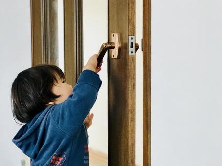 Child opening the door