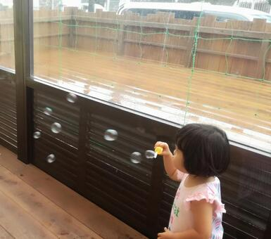 Girl enjoying soap bubbles