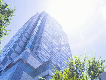 Pale blue sky and high rise office building