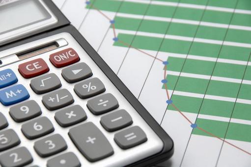 비즈니스 이미지 - 계산기와 그래프