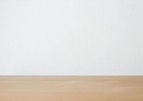 White wall and wooden desk