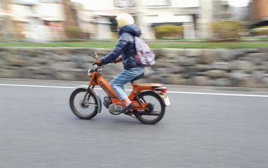 A sprinting motorcycle