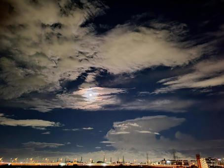Autumn moonlit night, street lights and cumulonimbus clouds