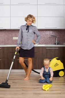 Working mother placing a vacuum cleaner with my son who imitates cleaning 14