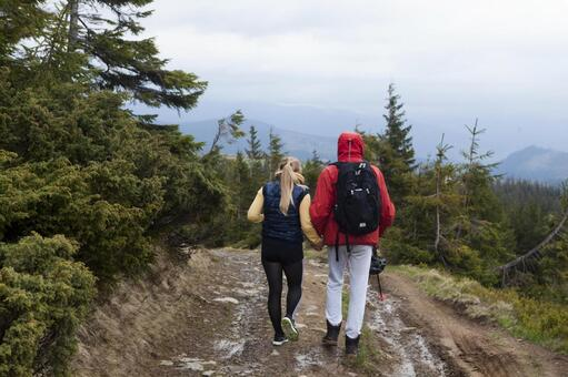 A couple of trekkers walking on the mountain path 22
