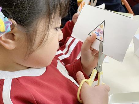 Kindergarten children practicing scissors