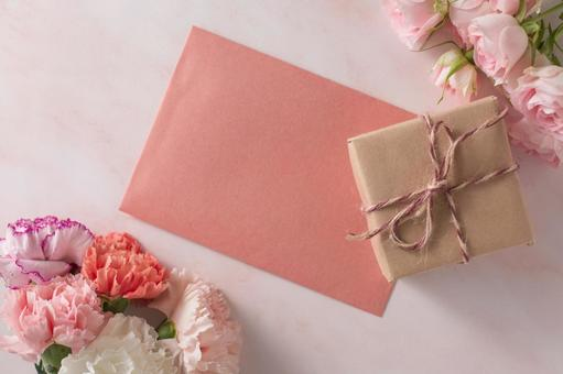 Mother's Day image Pink roses and carnations, gifts and letters
