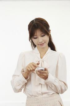 A woman with a mobile phone 11