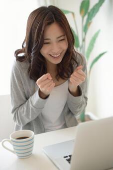 A woman touching a PC 20