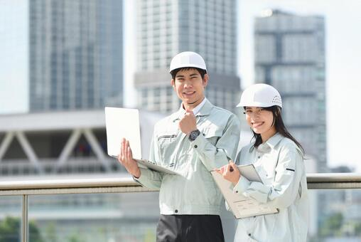 Skyscrapers and male and female workers