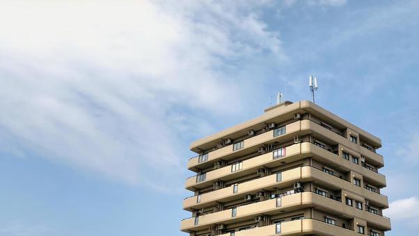 Blue sky and condominium real estate image