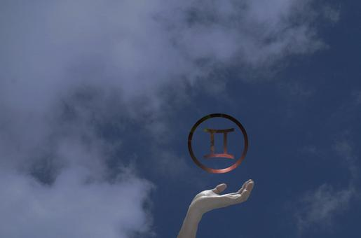 Hands supporting the Gemini mark (spiritual)