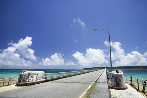 Kurima Bridge, which supports traffic on Kurima Island, blue sky in summer, and seascape of coral reefs