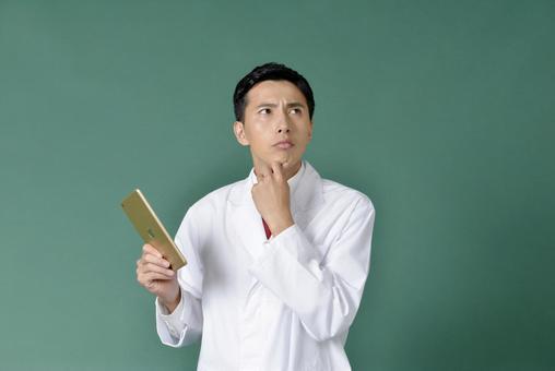 Male wearing white coat under consideration 6