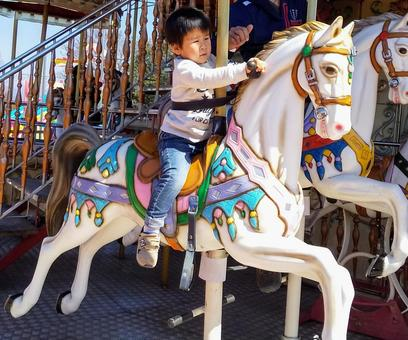 Children riding a merry-go-round