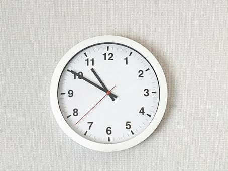 White wall clock on white background