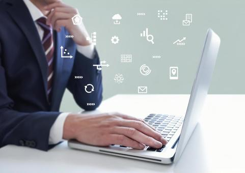 Businessmen and icons operating PCs