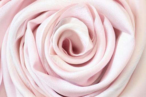 美麗的布料真絲包裹的玫瑰卷玫瑰布真絲粉紅色日式紋理背景中心