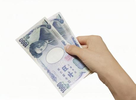 지폐 (1000 엔)와 손 0427