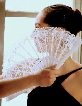 Women with folding fan 20