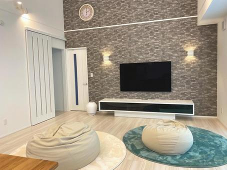 Living room with round carpet and cushions