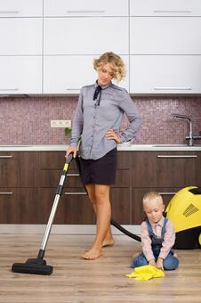 Working mother hanging vacuum with my son who imitates cleaning 13