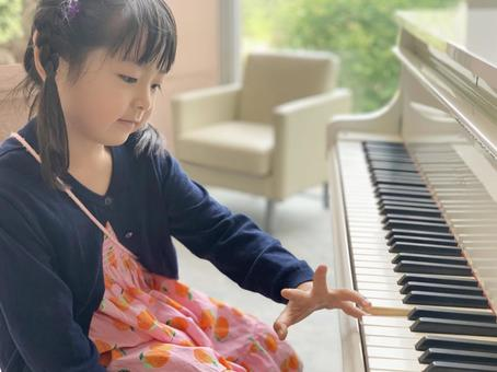 Girl playing the piano left hand
