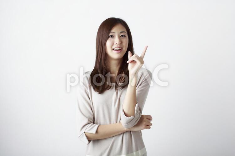 ひらめいた女性の写真