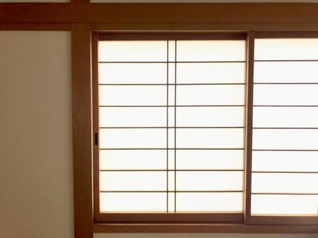 Japanese-style room with shoji windows