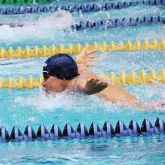 Butterfly swimming boy