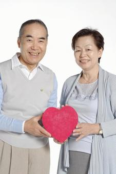Elderly couple with heart gift box 3