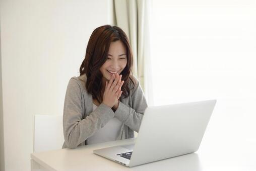 A woman touching a PC 13