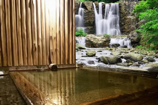 Open-air bath with a view of the waterfall