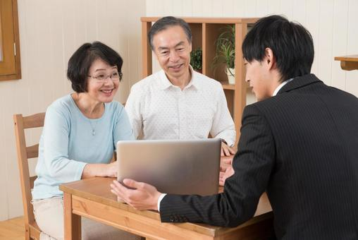 Senior couple receiving explanation from salesperson 3