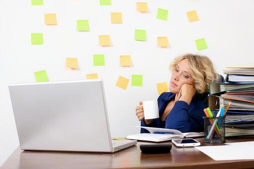 Working mother at work at the desk in front of the wall with many sticky notes 15
