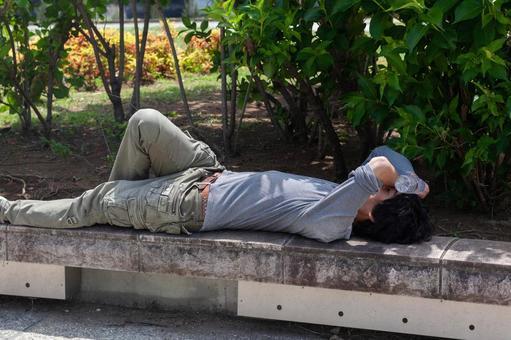 A man lying down with heat stroke
