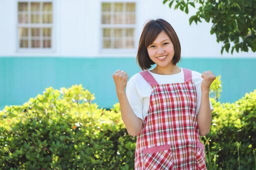 Woman in apron wearing guts pose