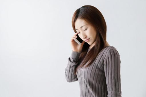 A woman who speaks on a smartphone (sad)