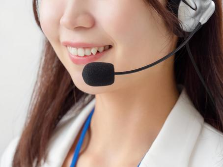Image of a female operator wearing a headset