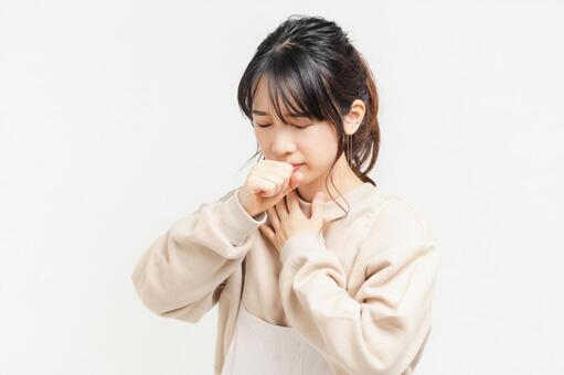 Young woman with a sore throat