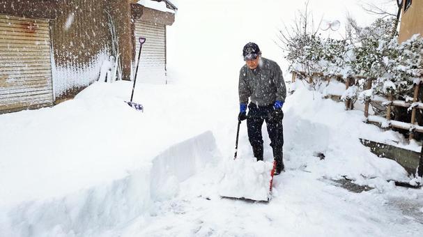 Snow shove in front of garage