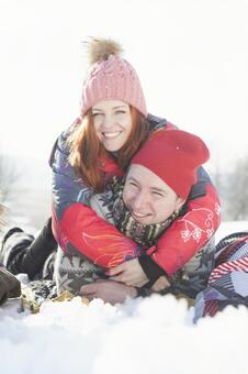 Couple lying on the snow 1