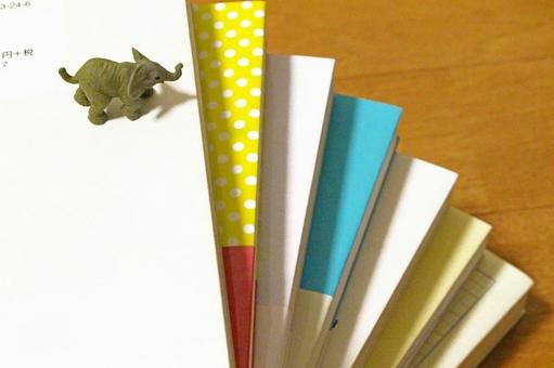 A stacked book and an elephant overlooking 3