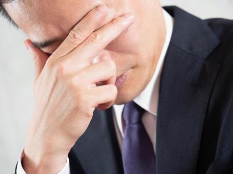 A male businessman who regrets having beard hair loss