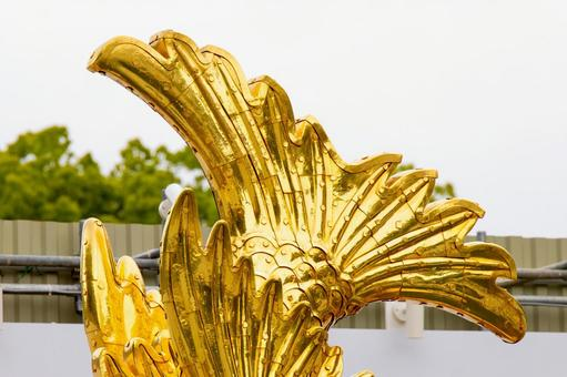 Gold killer whale caudal fin