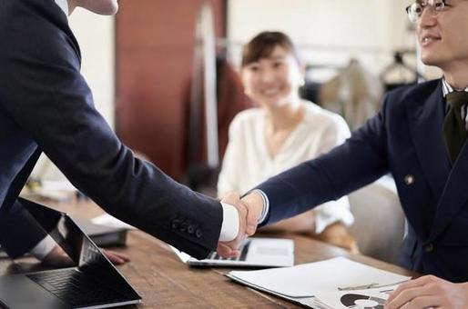 Hands of Asian businessmen shaking hands