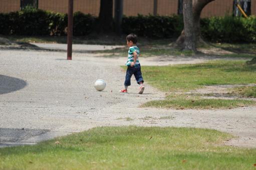A boy kicking a ball