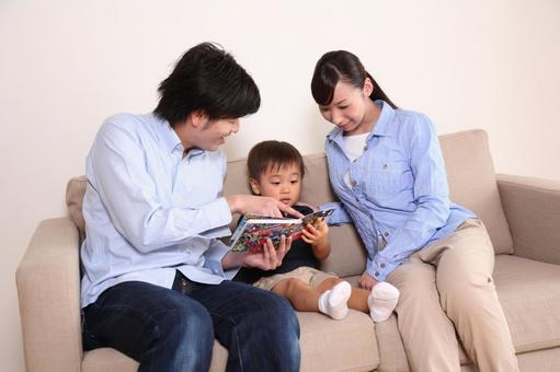 Family reading a picture book 3