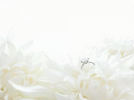 White dahlia and engagement ring frame